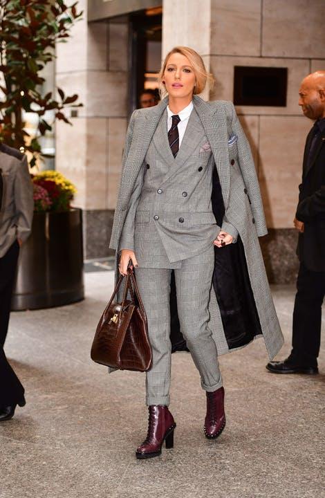 Terno Ralph Lauren e botas Michael Kors.